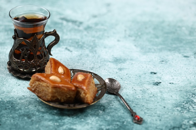 Traditional armudu (tea cup) with pakhlava