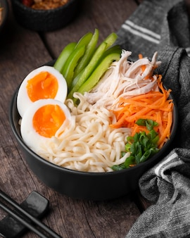 Traditional asian noodles with eggs and vegetables