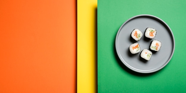 Traditional asian sushi rolls on abstract background