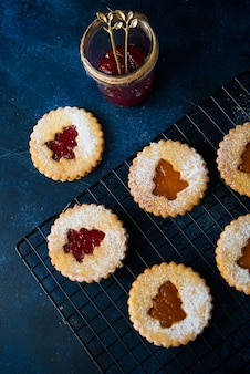 Traditional austrian linzer cookies with jam, homemade cakes, selective focus