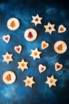 Traditional austrian linzer cookies with jam, homemade cakes, top view