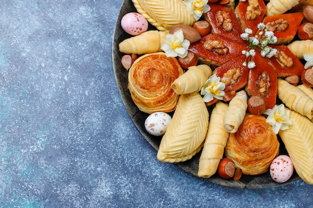 Traditional azerbaijan holiday novruz cookies baklavas and shakarburas on black tray plate