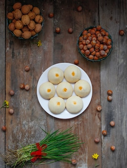 Traditional azerbaijani holiday cookies shakar chorek on white plate on rustic
