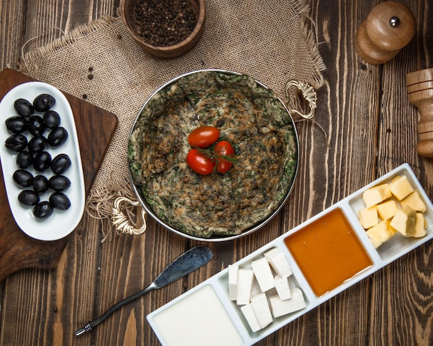 Traditional azerbaijani kuku with cherry tomato