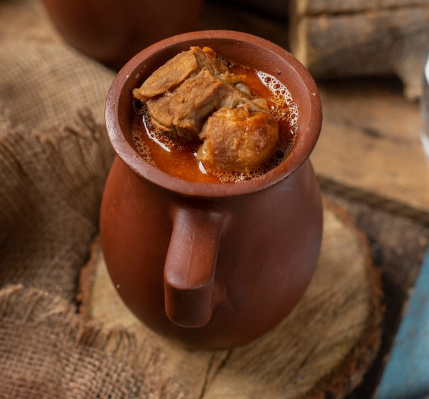 Traditional azerbaijani meal piti in pottery cup with meat.