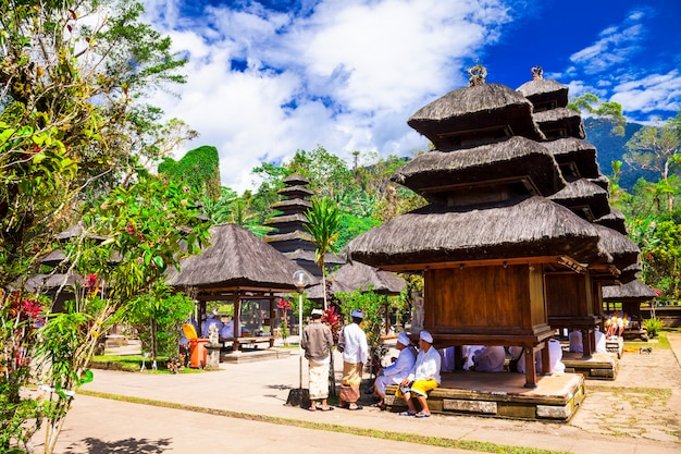 Traditional balinese temple with local people for ceremony.