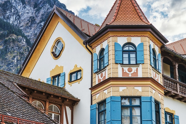 Traditional bavarian white house in the mountains, germany