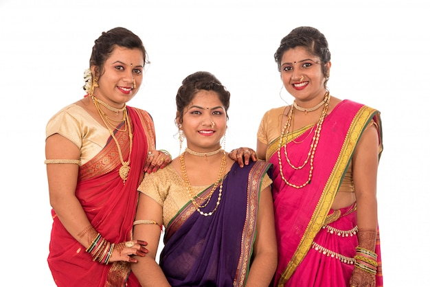Traditional beautiful indian young girls in saree posing on white space