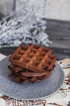 Traditional belgian waffles with cocoa on wooden