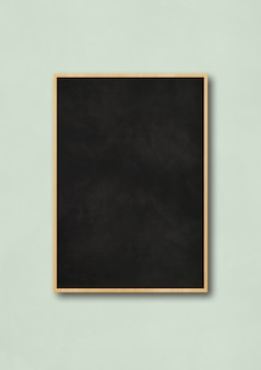 Traditional black board isolated on a light blue background. blank vertical mockup template