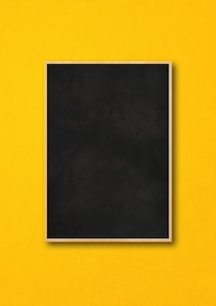 Traditional black board isolated on a yellow background.