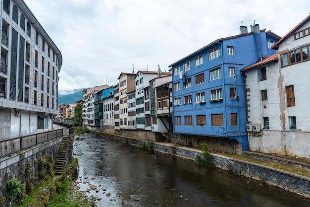 Traditional blue house in the town of azkoitia next to the urola river, gipuzkoa. basque country