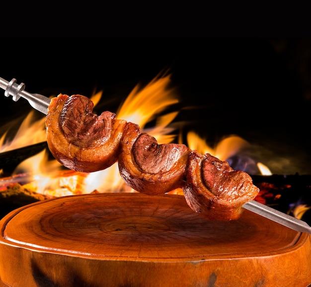 Traditional brazilian barbecue near fire