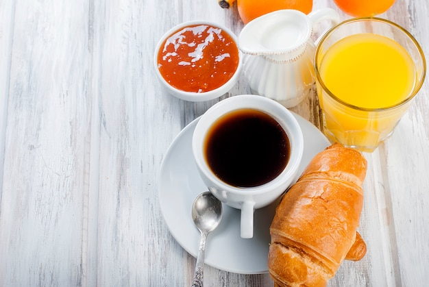 Traditional breakfast croissant, and coffee, jam ,orange juice