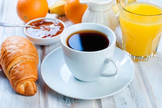 Traditional breakfast croissant, and coffee, jam ,orange juice