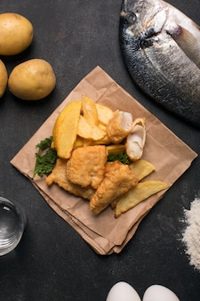 Traditional british fish and chips on the dark surface