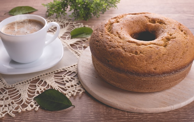 Traditional cake and a cup of milk with coffee  grandmother cake
