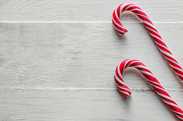 Traditional  candy canes on wooden background. new year and christmas