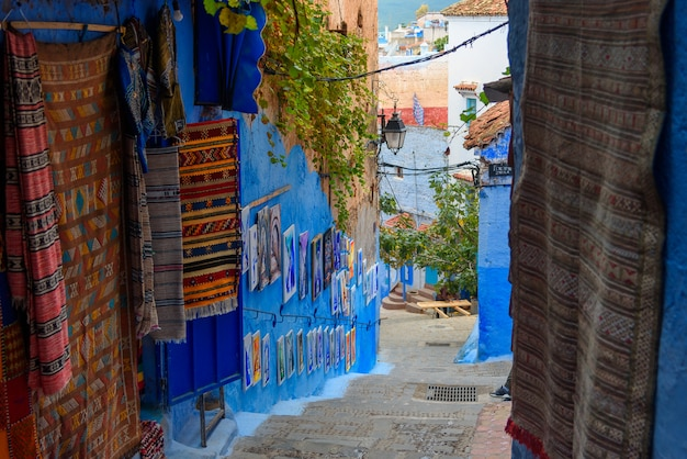 Traditional carpets on the blue chefchaouen street in morocco