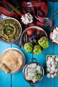 Traditional caucasian mixed foods on a blue table.