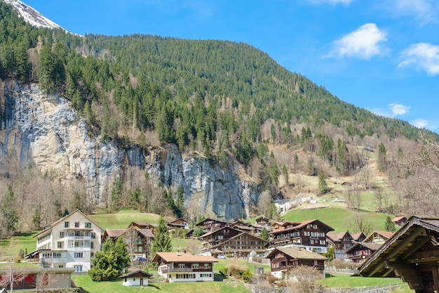 Traditional chalets of village in lauterbrunnen valley at spring