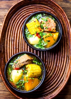 Traditional chilean pork soup in bowls