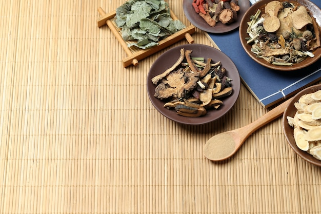 Traditional chinese medicine on bamboo desk