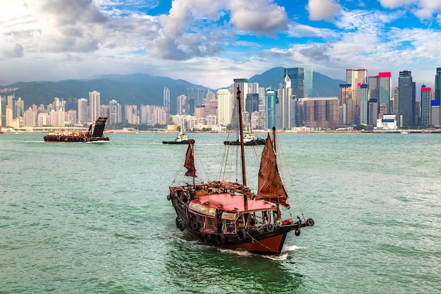 Traditional chinese wooden sailing ship in victoria harbour in hong kong