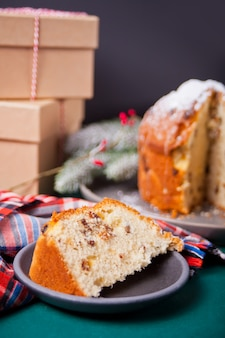 Traditional christmas cake panettone with fruits and nuts with christmas decoration