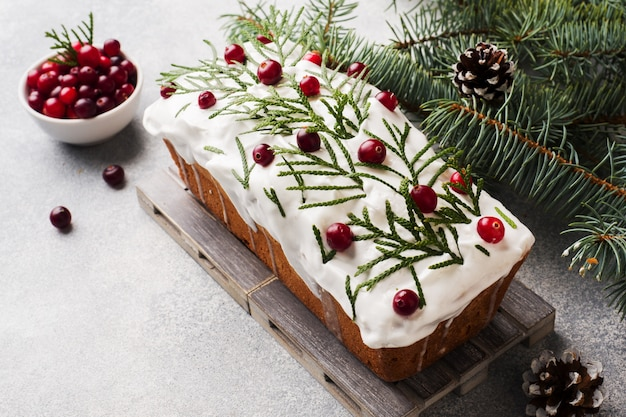 Traditional christmas cake with cranberries on gray table background. horizontal. copy space.