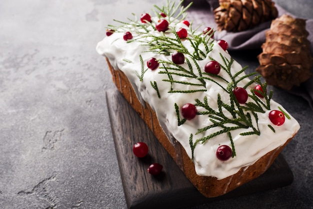 Traditional christmas cake with cranberries on gray table. horizontal. copy space.