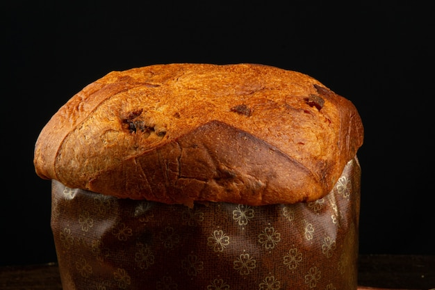 Traditional christmas food panettone with black background.