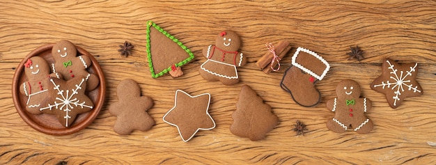 Traditional christmas gingerbread cookies over a wooden table. panoramic format.