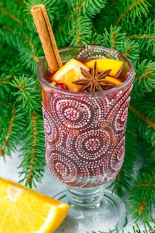 Traditional christmas mulled red wine with spices (cinnamon, star anise, cardamom) and fruits