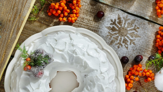 Traditional christmas and new year cake with cranberries and frosting