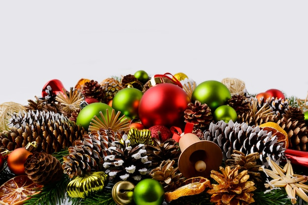 Traditional christmas ornaments, fir branches and pine cones