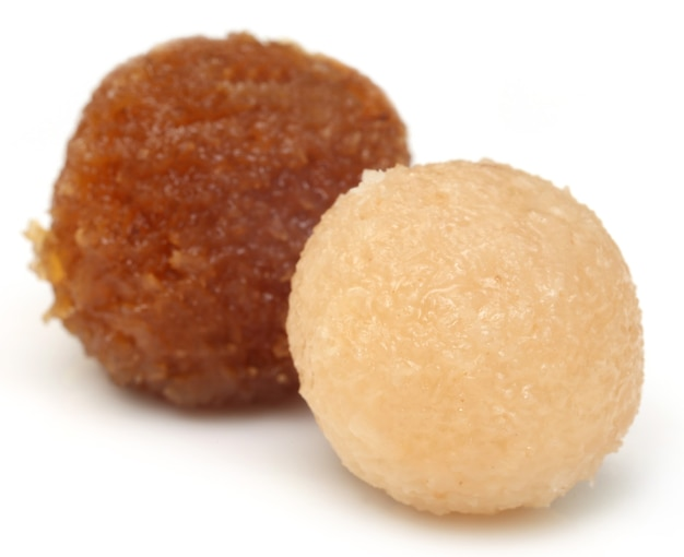 Traditional coconut laddu of southeast asia over white background