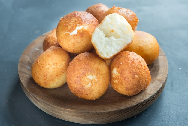 Traditional colombian buñuelo deep fried cheese bread