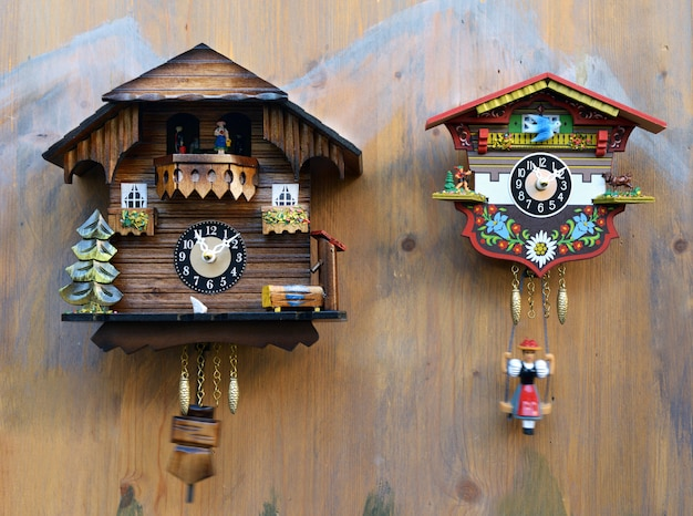 Traditional colorful wooden cuckoo clocks