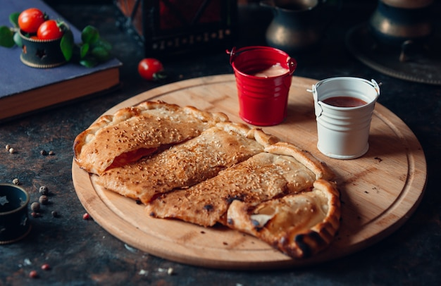 Traditional crepe kutab sliced and served with sauces.