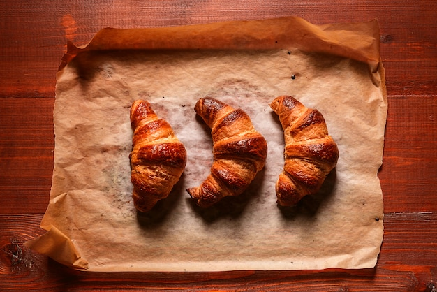 Traditional croissants on a wooden table