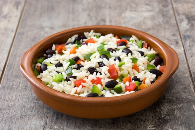 Traditional cuban rice with black beans and pepper