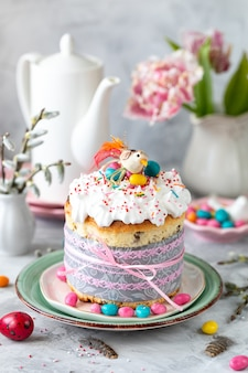 Traditional cupcake easter cake. easter cake, colored eggs and spring flowers. vertical