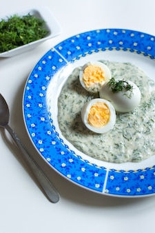Traditional czech dill gravy with boiled eggs