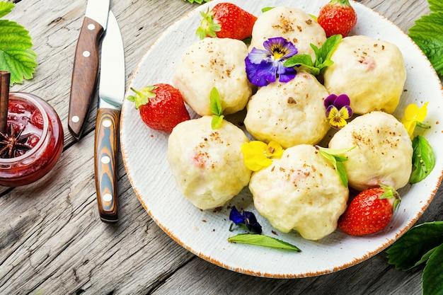 Traditional czech dumplings with berries.dumplings with strawberries or knedlik.