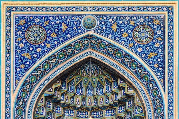 Traditional decoration over the entrance to the iranian mosque in yazd.