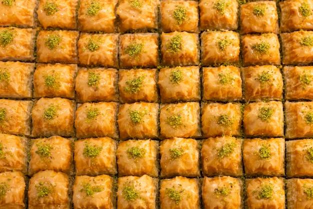 Traditional delicious turkish dessert baklava in the shop window showcase