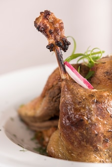 Traditional dish with baked drumstick duck and sour cabbage,  decorated with herbs