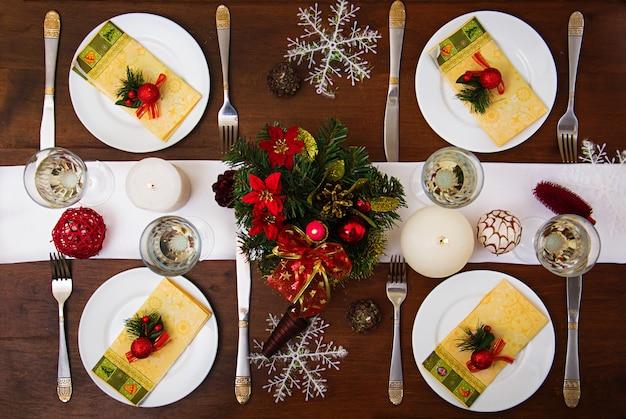 Traditional dishware on christmas table. .