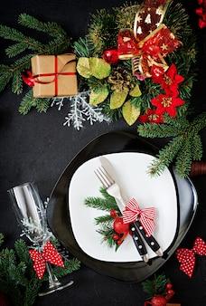 Traditional dishware on christmas table.